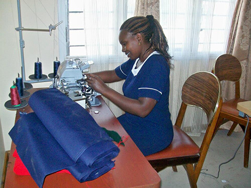 Education-2---Woman-at-sewing-machine-web